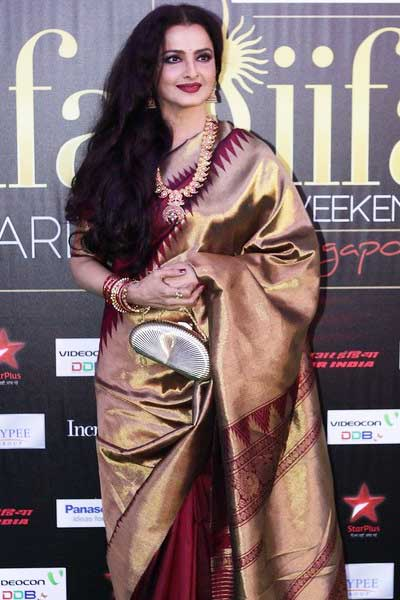 Rekha in her trademark Kanjivaram silk sari
